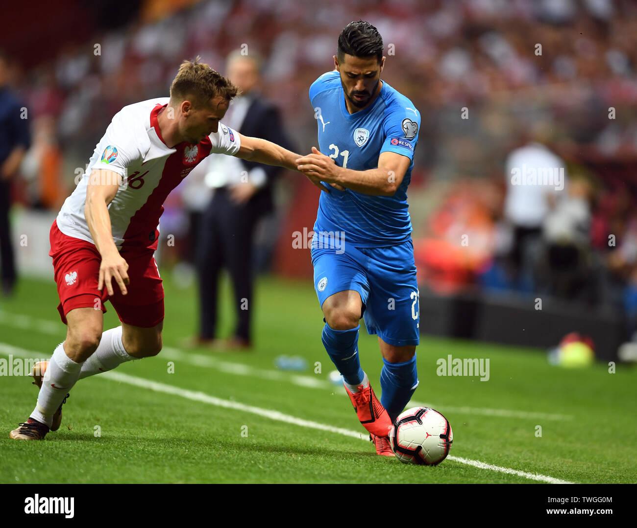 Warsaw, Poland, June 10, 2019: EURO 2020 qualifing round, group stage, Poland wins 4:0 with Izarel on PGE Narodowy. Tomasz Kedziora (Poland) Beram Kayal (Izrael) - Stock Image
