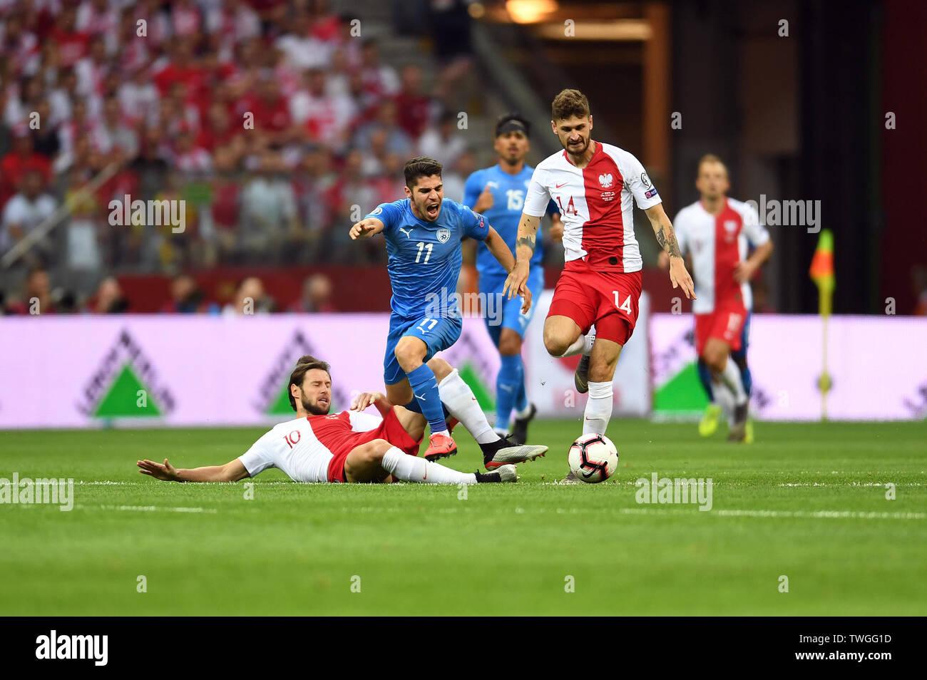 Warsaw, Poland, June 10, 2019: EURO 2020 qualifing round, group stage, Poland wins 4:0 with Izarel on PGE Narodowy. Grzegorz Krychowiak (Poland) Manor Solomon (Izrael) Mateusz Klich (Poland) - Stock Image
