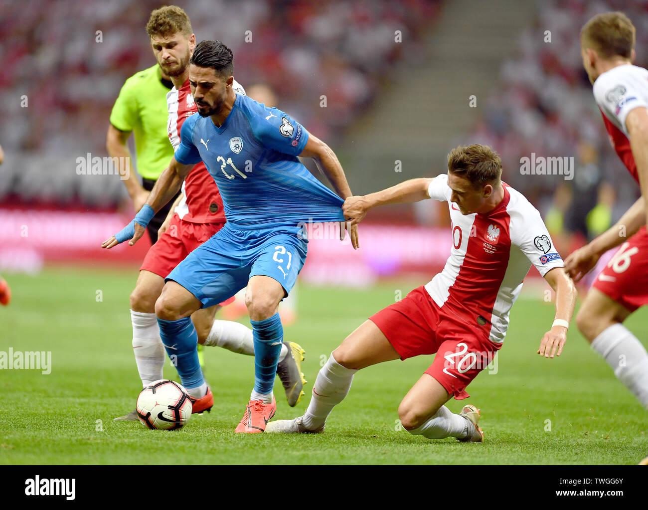 Warsaw, Poland, June 10, 2019: EURO 2020 qualifing round, group stage, Poland wins 4:0 with Izarel on PGE Narodowy. Mateusz Klich (Poland) Beram Kayal (Izrael) Piotr Zielinski (Poland) - Stock Image