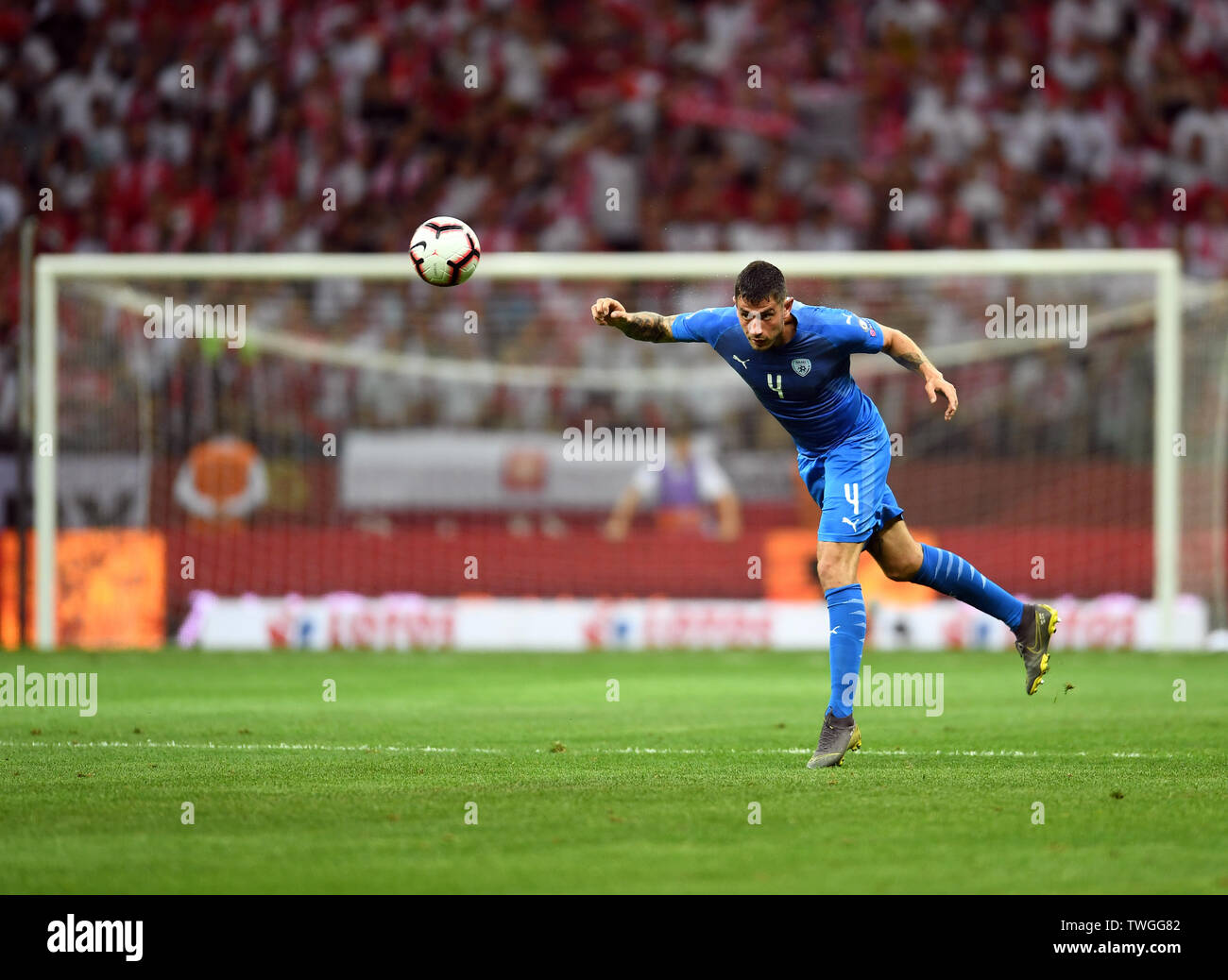 Warsaw, Poland, June 10, 2019: EURO 2020 qualifing round, group stage, Poland wins 4:0 with Izarel on PGE Narodowy. Nir Bitton (Izrael) headers the ball - Stock Image