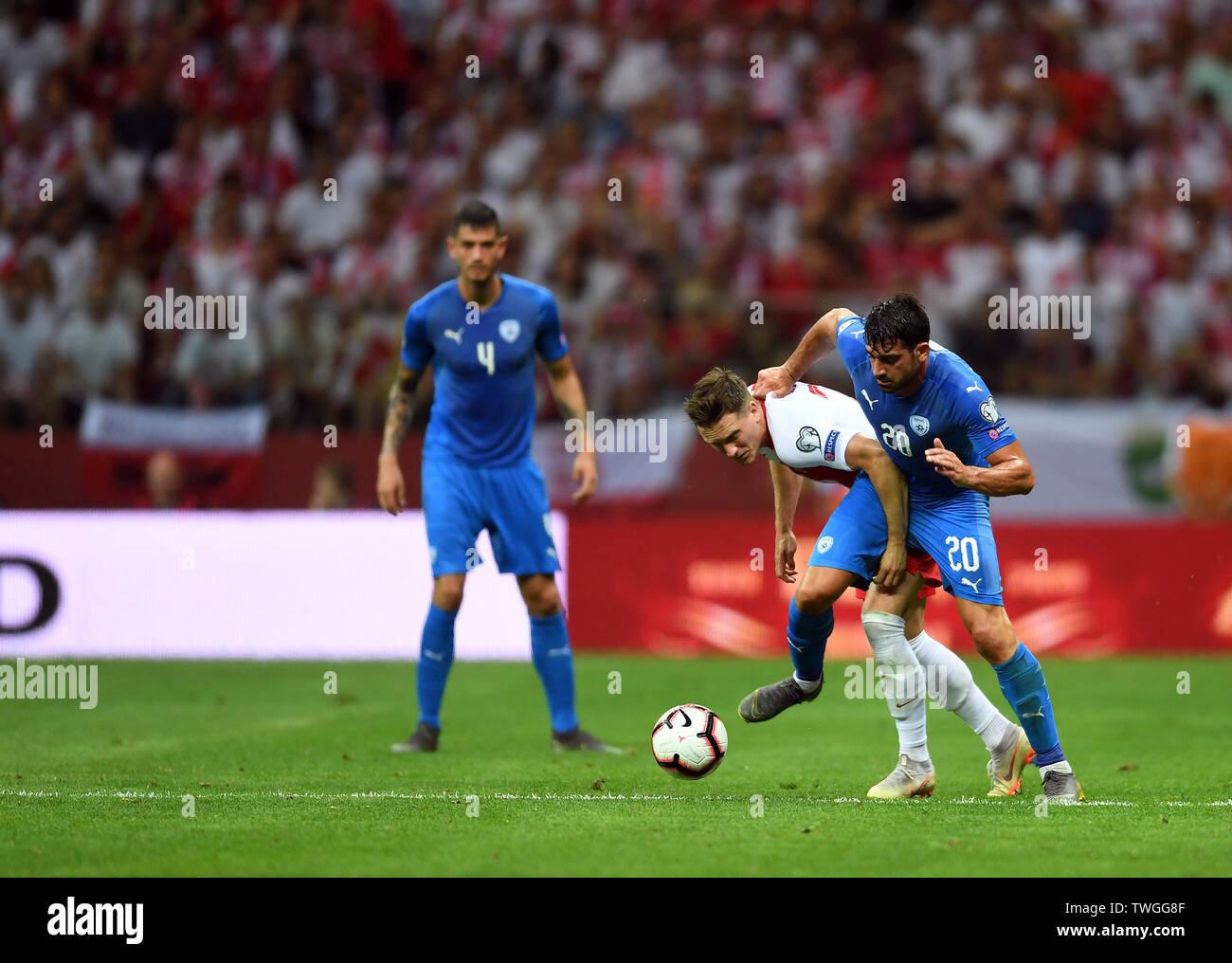Warsaw, Poland, June 10, 2019: EURO 2020 qualifing round, group stage, Poland wins 4:0 with Izarel on PGE Narodowy. Piotr Zielinski (Poland)  Omri Ben Harush (Izrael) - Stock Image