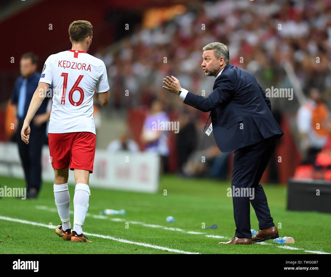 Warsaw, Poland, June 10, 2019: EURO 2020 qualifing round, group stage, Poland wins 4:0 with Izarel on PGE Narodowy. Tomasz Kedziora (Poland) Jerzy Brzeczek Coach (Poland) - Stock Image