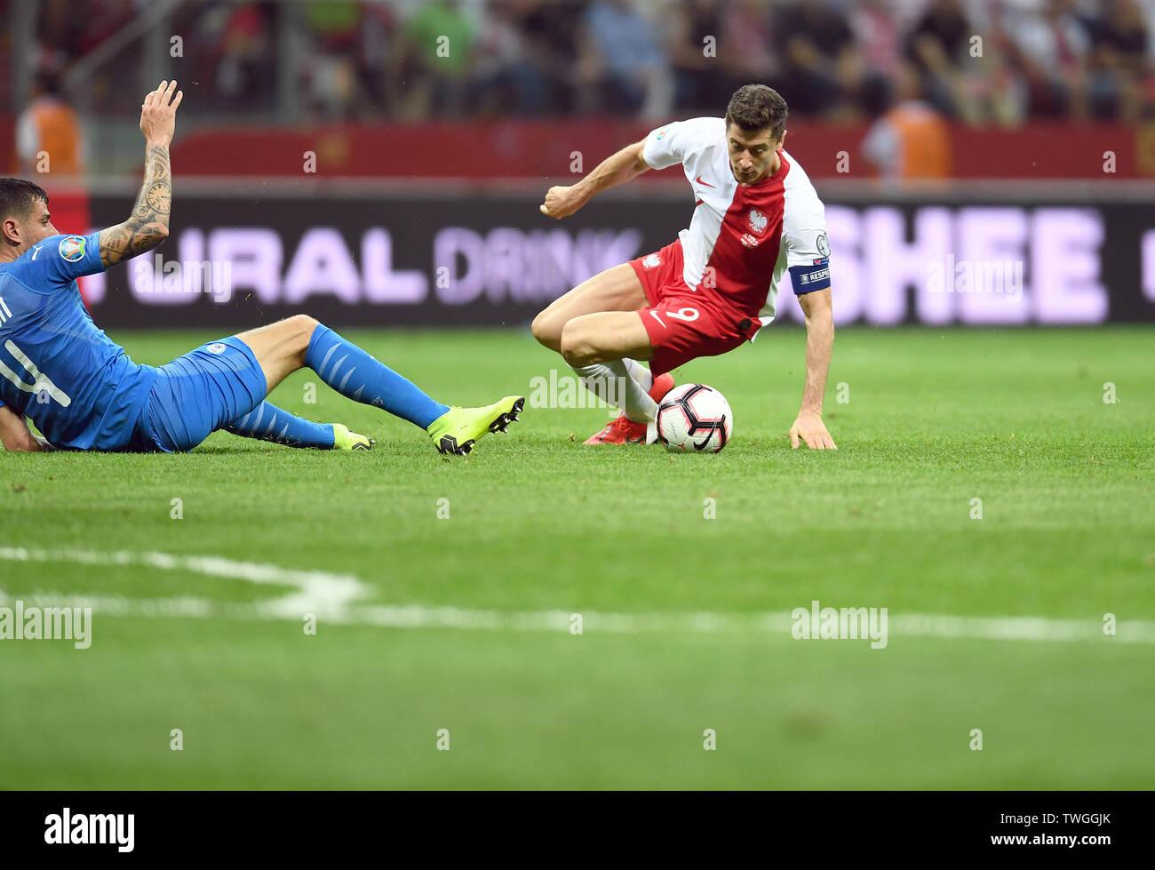 Warsaw, Poland, June 10, 2019: EURO 2020 qualifing round, group stage, Poland wins 4:0 with Izarel on PGE Narodowy. Nir Bitton (Izrael) Robert Lewandowski (Poland) - Stock Image