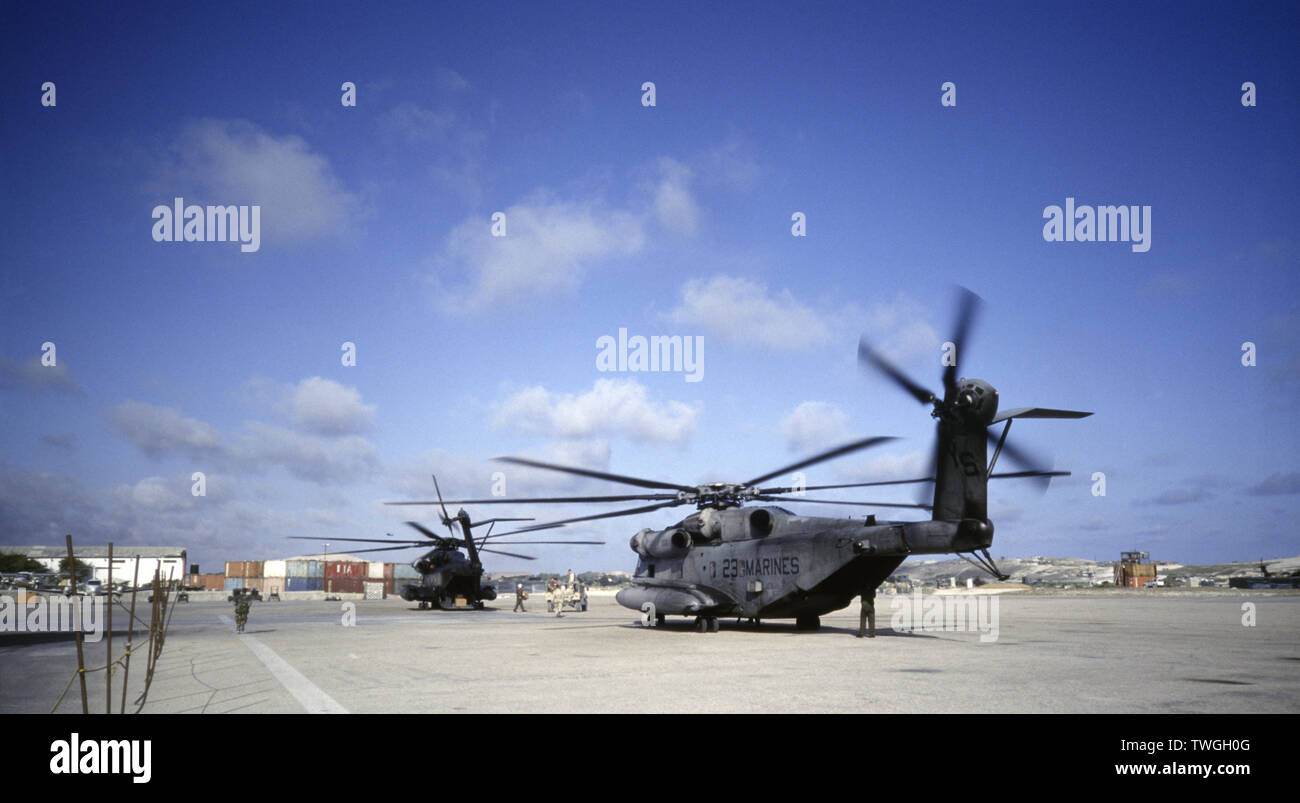 1st November 1993 Two U.S. Marine Corps Sikorsky CH-53E Sea Stallion helicopters about to take off at Mogadishu airport. A U.S Army humvee is parked between them. - Stock Image