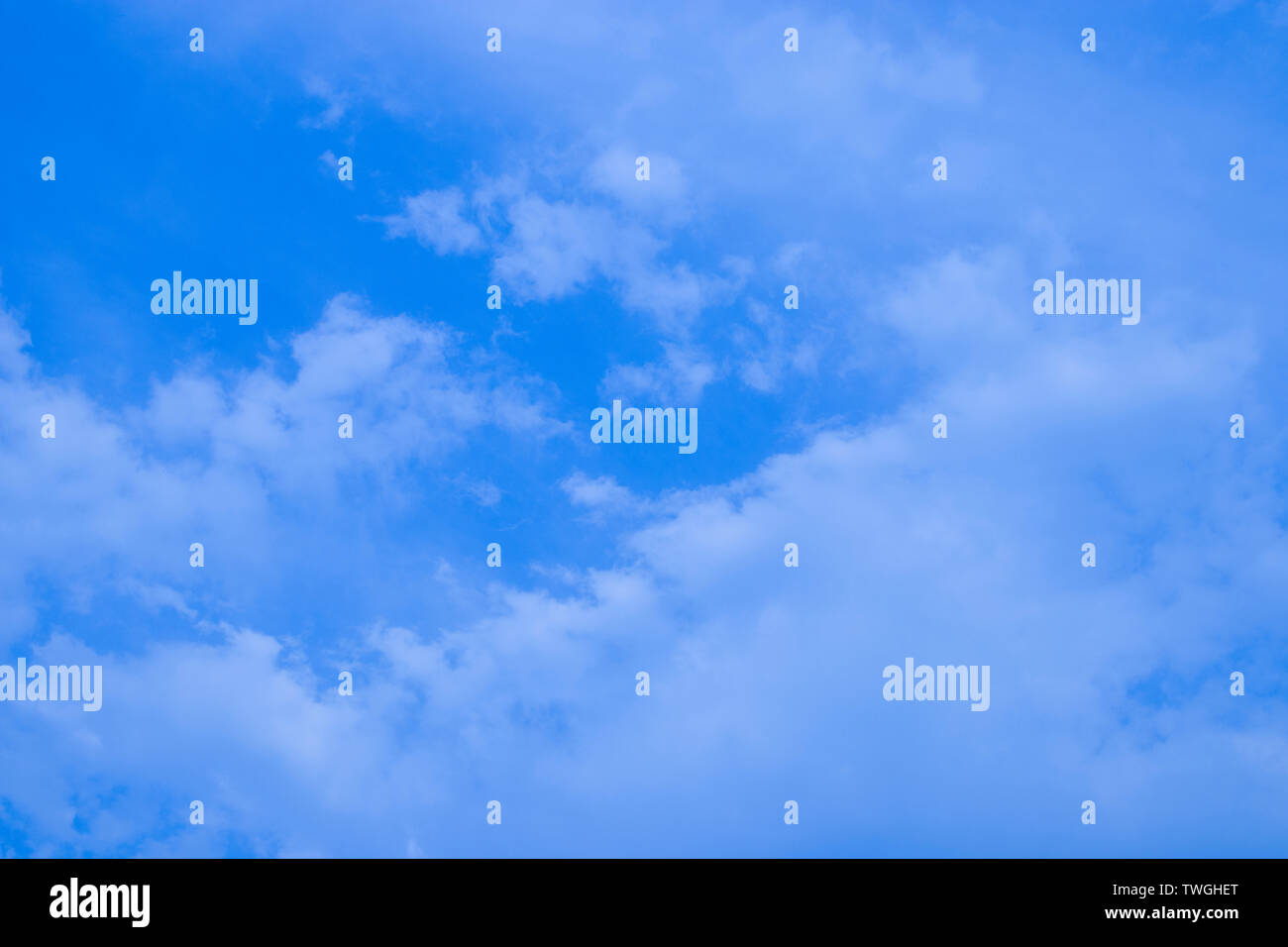 Blue sky with clouds, fluffy white cloud on air clear blue sky weather background texture. High resolution image gallery. - Stock Image