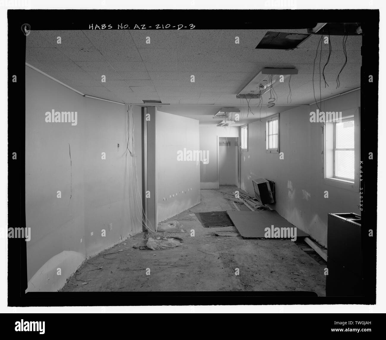 REMODELED OFFICE ROOM FROM EAST SHOWING DIAGONAL PARTITION WITH ADDED GYPSUM BOARD - Fort Huachuca, Cavalry Stable, Clarkson Road, Sierra Vista, Cochise County, AZ - Stock Image