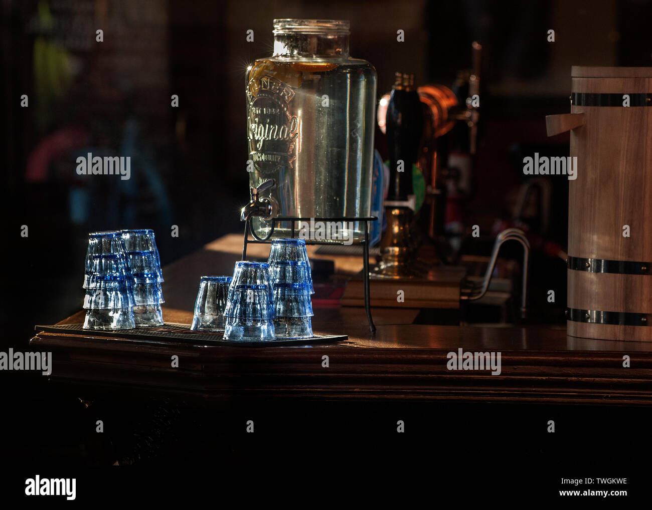interior bar at the Grafton pub, kentish town, glasses and water dispenser lit by sunshine, Stock Photo