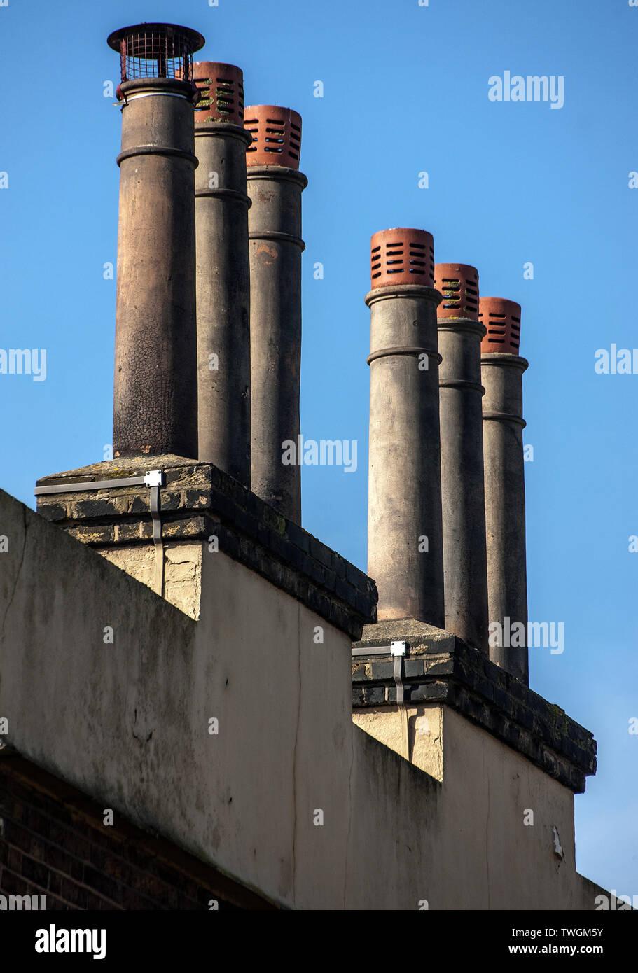 tall Louvred Chimney pots six chimney pots on rectagle stack. - Stock Image