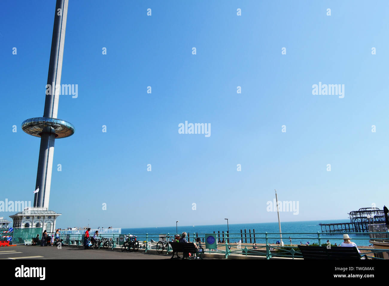 Brighton/UK - August 17, 2016: Observation tower British Airways i360 and remains of the West Pier in Brighton in a happy sunny summer day. Stock Photo