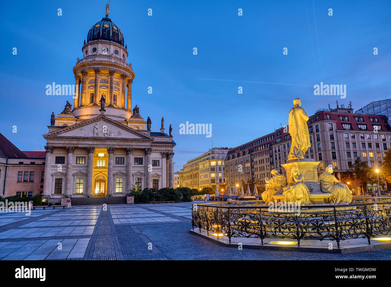 The French Cathedral and the Schiller Monument at the Gendarmenmarkt in Berlin at dawn Stock Photo