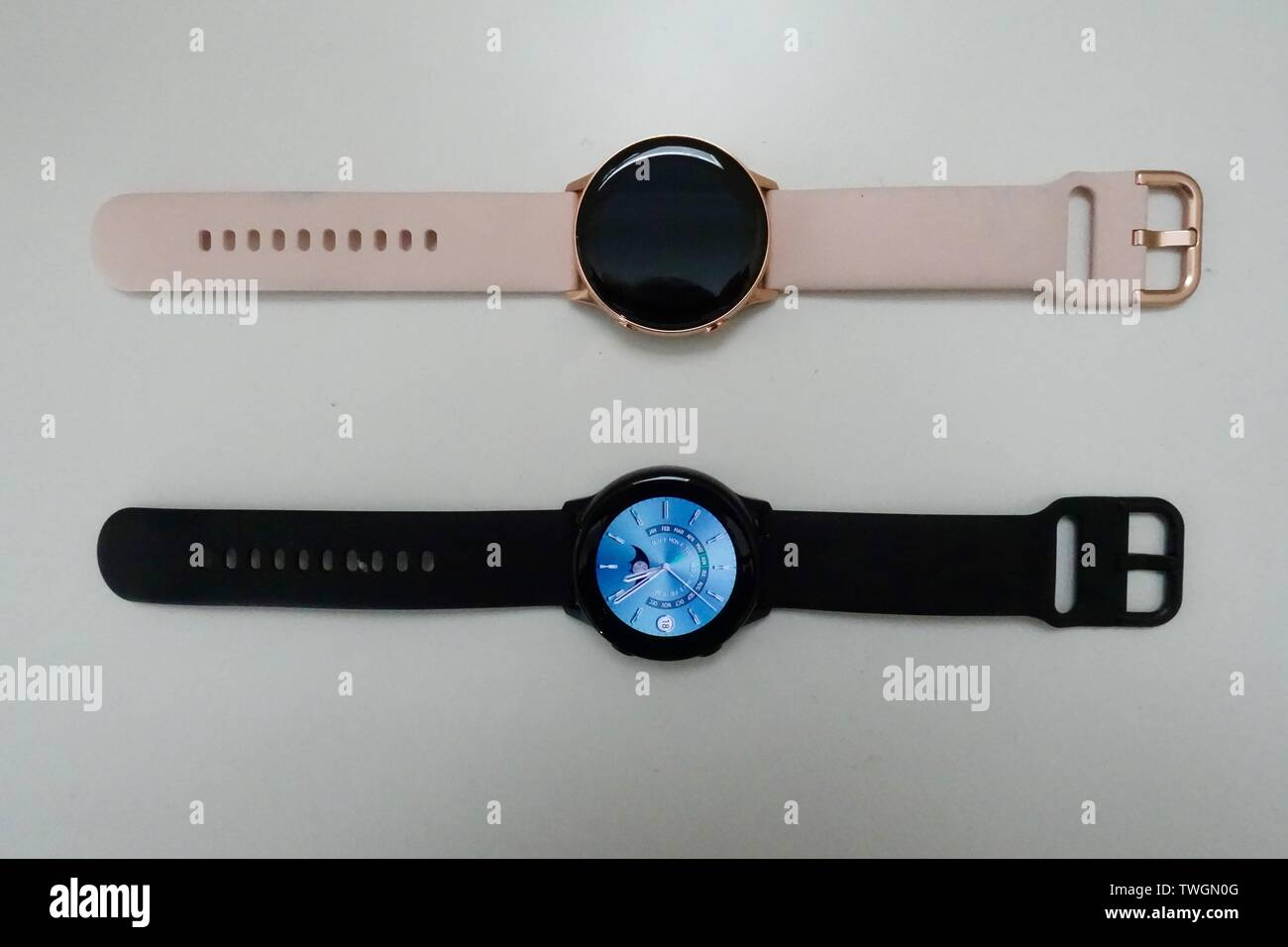 A Black And Rose Gold Samsung Galaxy Active Smart Watches Laying Next To Each Other On A White Background Stock Photo Alamy