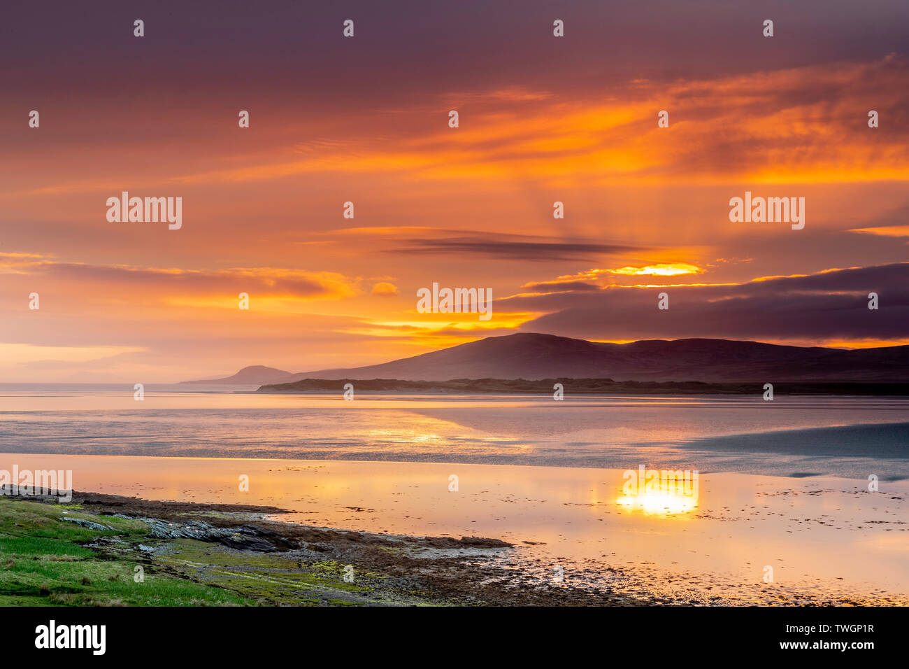 Sunrise over Loch Gruinart from the Ardnave Peninsula - Stock Image