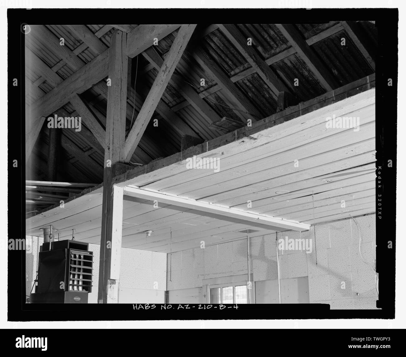 ROOF FRAMING AND BOARD-AND-BATTEN CEILING FROM CENTER AISLE LOOKING NORTHWEST - Fort Huachuca, Cavalry Stable, Clarkson Road, Sierra Vista, Cochise County, AZ - Stock Image