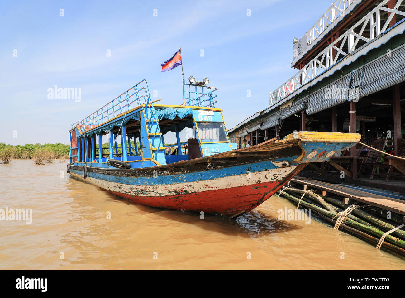 A tourist boat moored at the floating crocodile farm on Tonlé Sap Lake, near to Siem Reap, Cambodia, South East Asia - Stock Image