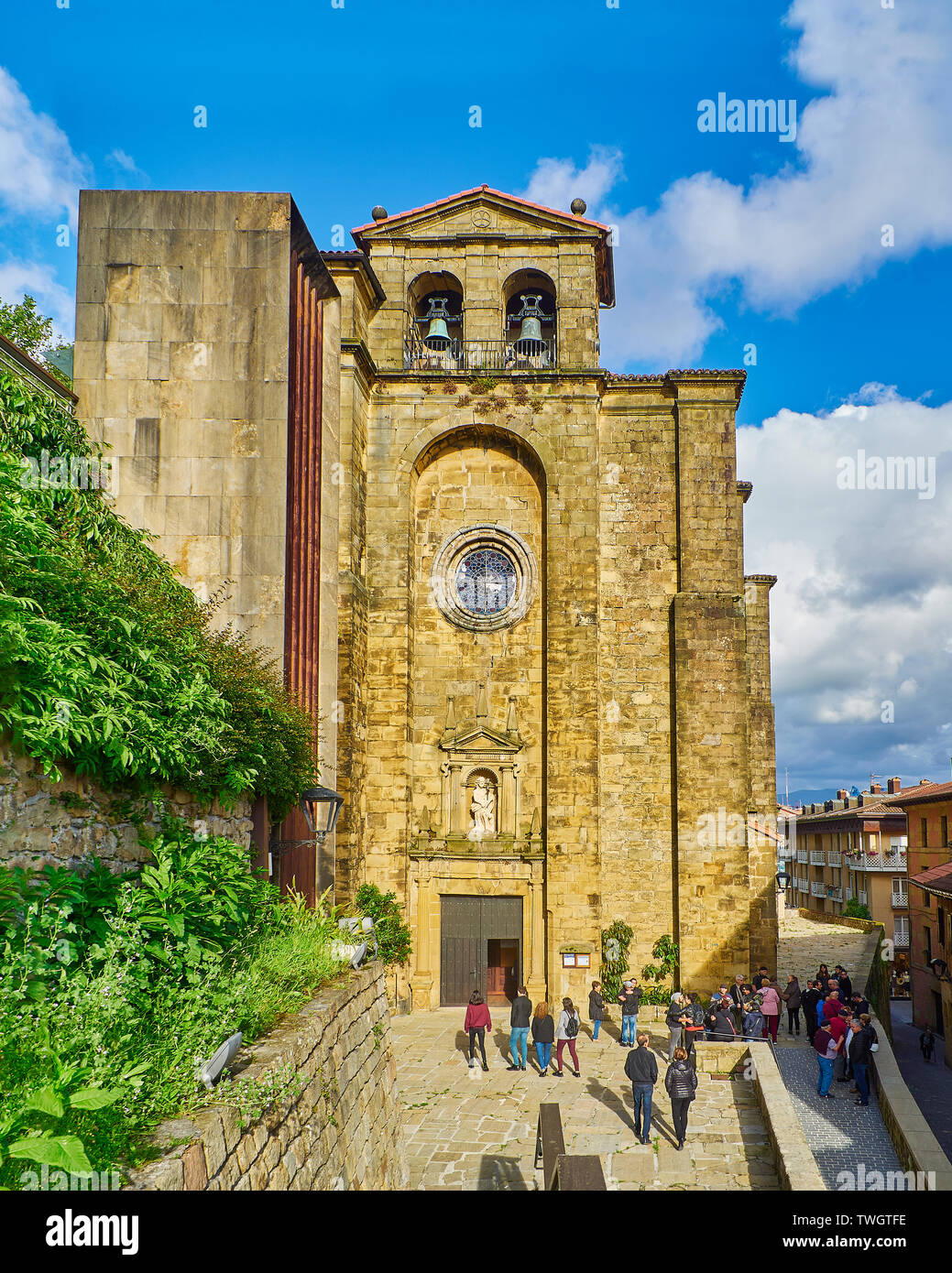 Principal facade of the Church of San Juan Bautista, located in the fishing village of Pasajes de San Juan on a sunny day. Gipuzkoa, Spain. - Stock Image