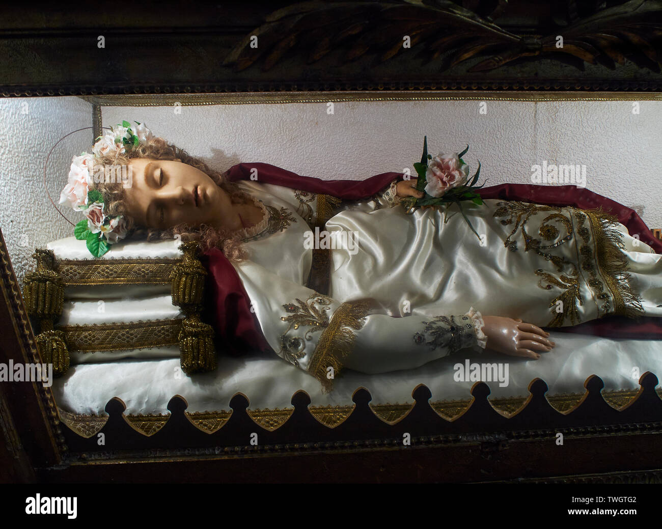 A wax image of Santa Faustina inside of the Church of San Juan Bautista, located in the fishing village of Pasajes de San Juan. Gipuzkoa, Spain. - Stock Image