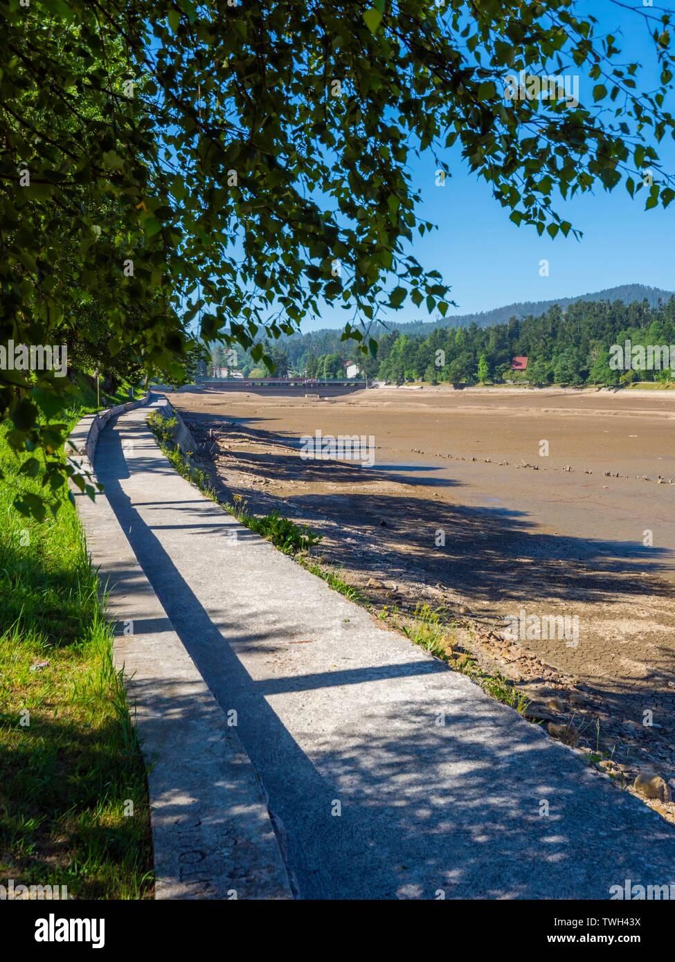 Dried lake-bed Bajer in Fuzine Croatia Spring 2019 coastline promenade Stock Photo