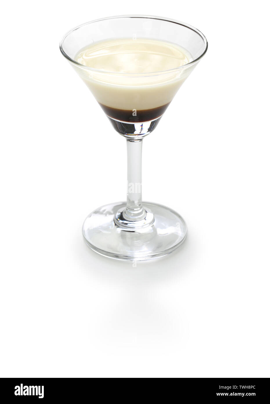 black and white, two color layered cocktail, homemade coffee liqueur and evaporated milk, alfonso13 - Stock Image