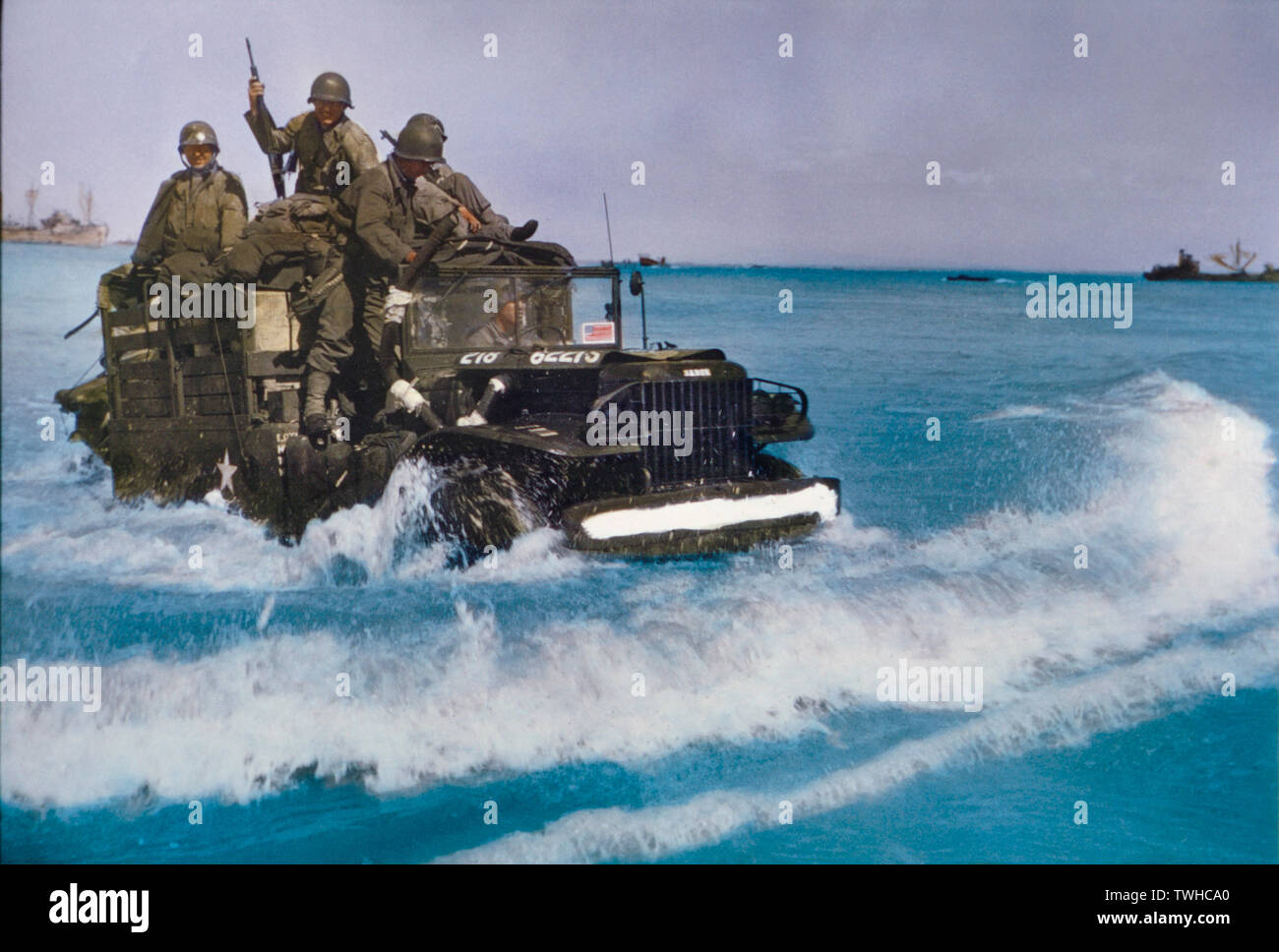 U.S. Military Truck with Soldiers driving through water toward shore during Invasion of Normandy, France, June 1944 Stock Photo