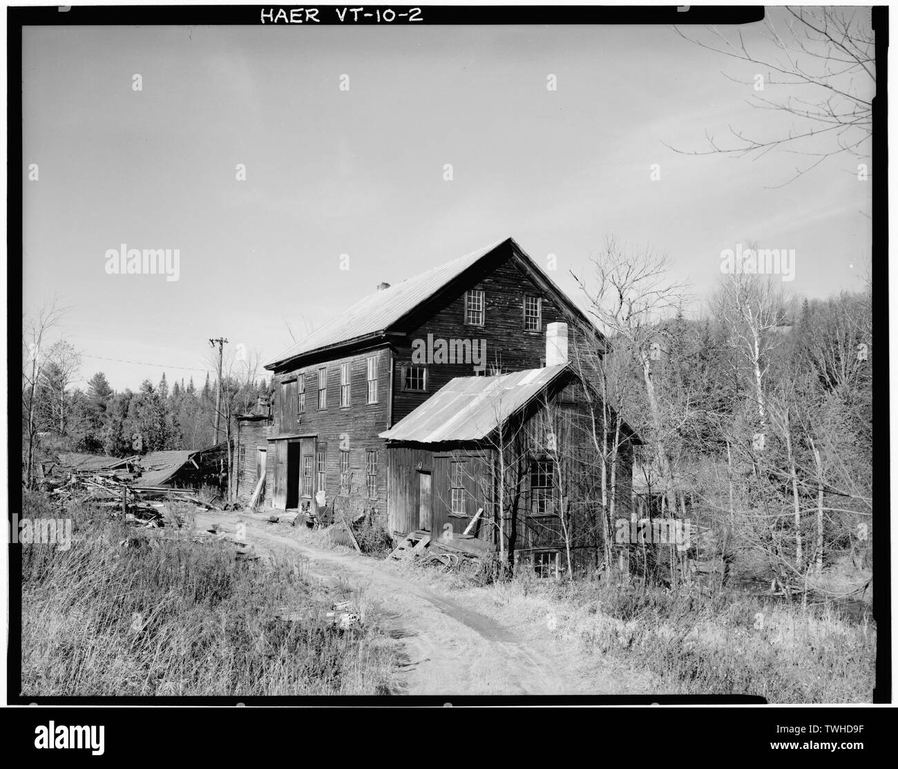 SE and SW elevations- view looking north showing Woodworking Mill and Blacksmith Shop - Ben Thresher's Mill, State Aid No. 1, Barnet, Caledonia County, VT; Rockefeller, Laurance S; Jack, Alexander; Judkins, James Loren; Stevens, Willard; Stevens, Henry; Gleason, Samuel; Barnet Cotton and Woolen Manufacturing Company; Herrin, John; Greenbank, Thomas; Greenbank, George; Taylor, James; Goodwillie, James; Shaw, William; McLaren, James; Somers, James S; Alexander Jack's Dye and Print Works; Smith, Isaac M; Bishop, Ora; Ford, Elmer S; Judkins, Fenton; Judkins, Donald; Pioneer Electric Light Company; - Stock Image