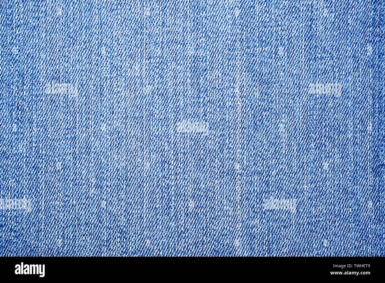 light blue denim jeans texture background, denim texture background. Stock Photo