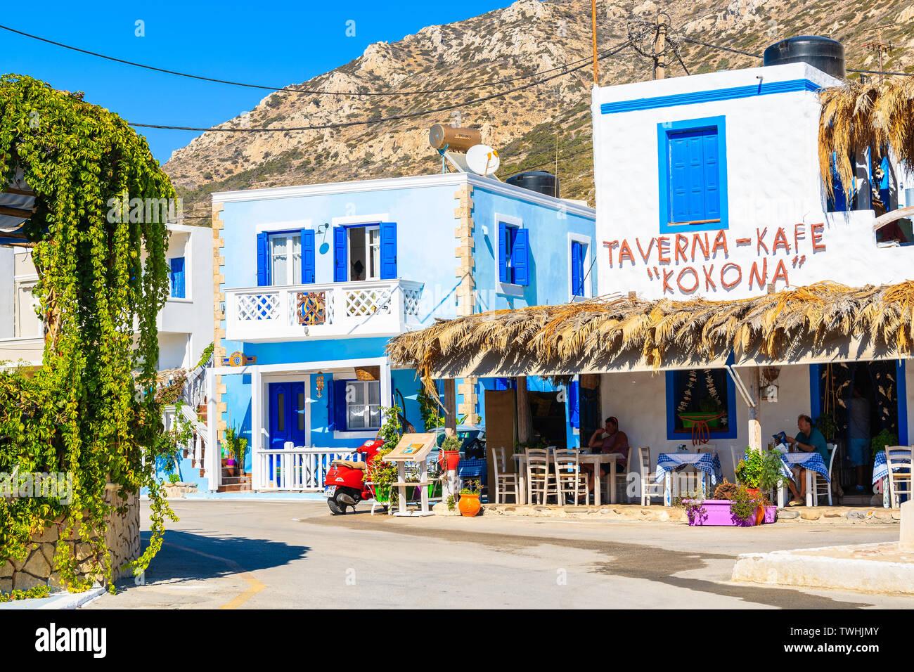 FINIKI PORT, KARPATHOS ISLAND - SEP 25, 2018: Typical Greek tavern in Finiki port on Karpathos island. Greece is very popular holiday destination in E Stock Photo