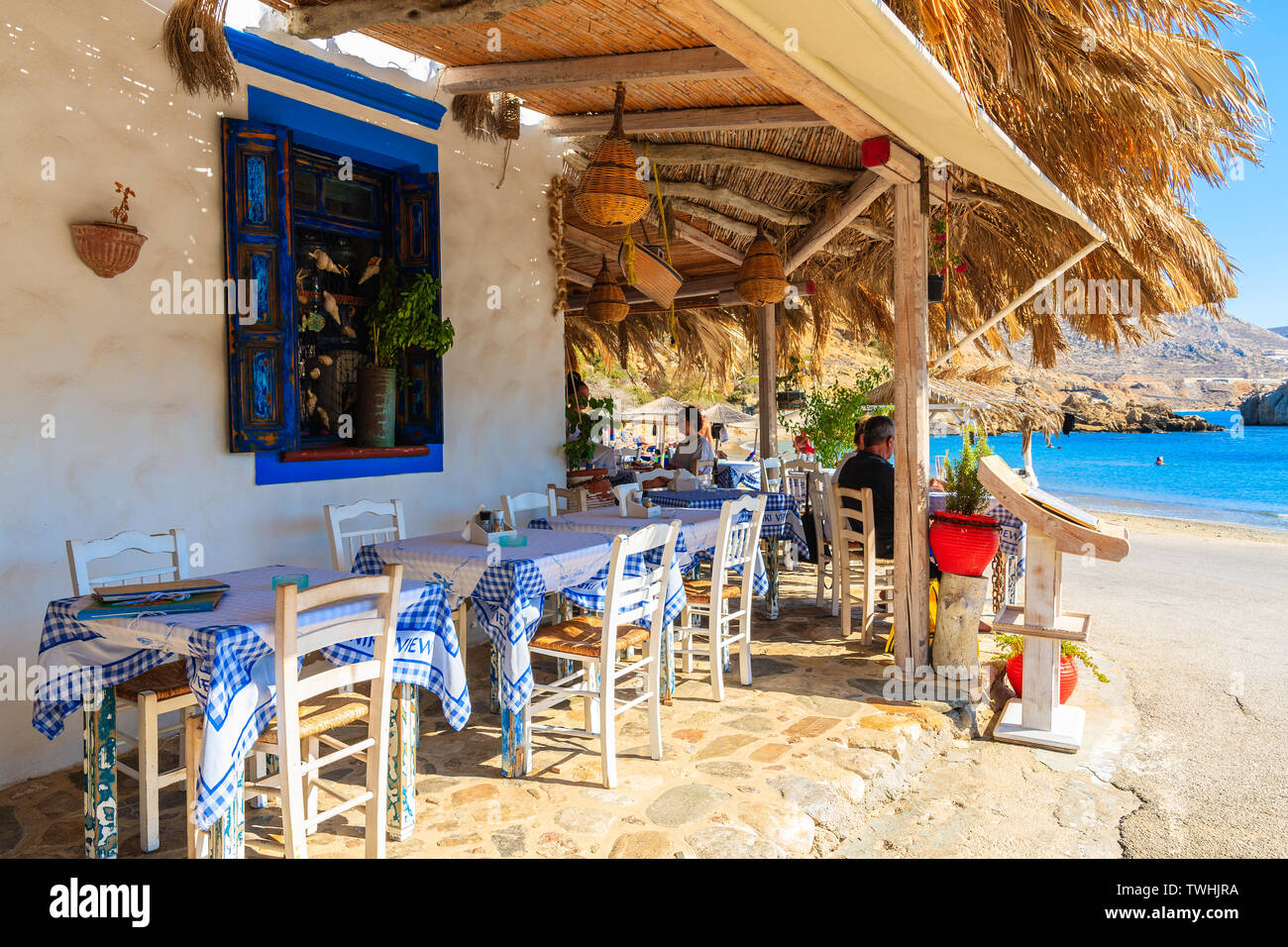 FINIKI PORT, KARPATHOS ISLAND - SEP 25, 2018: Typical Greek tavern in Finiki port on Karpathos island. Greece is very popular holiday destination in E Stock Photo