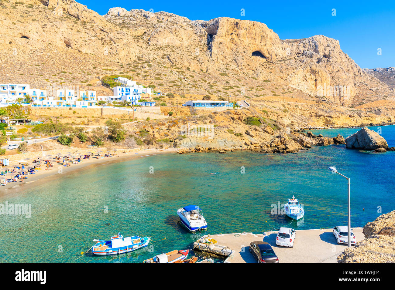 Fishing boats on turquoise sea water in Finiki port, Karpathos island, Greece Stock Photo