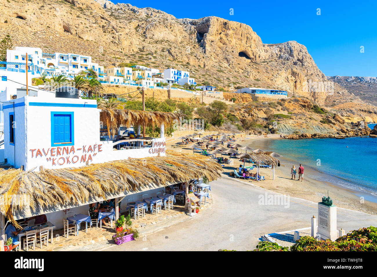 FINIKI PORT, KARPATHOS ISLAND - SEP 25, 2018: Typical Greek taverns in Finiki port on Karpathos island. Greece is very popular holiday destination in Stock Photo