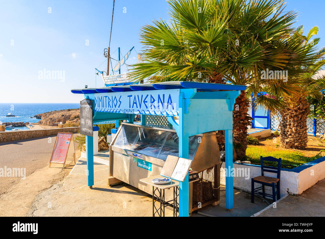 FINIKI PORT, KARPATHOS ISLAND - SEP 25, 2018: Stand presenting fresh fish to eat in taverna restaurant in village on coast of Karpathos island, Greece Stock Photo