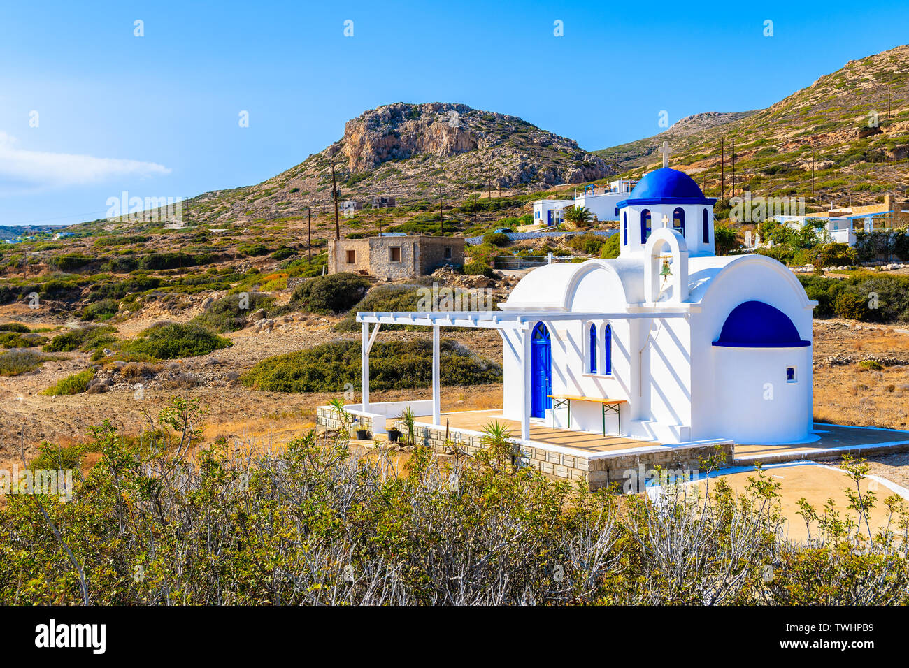 Traditional white church in rural landscape of Karpathos island, Greece Stock Photo