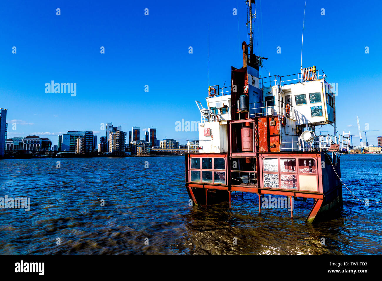 'A Slice of Reality' (2000) by Richard Wilson, a sliced section of a Sand Dredger, part of The Line Art Walk, Greenwich, London, UK - Stock Image