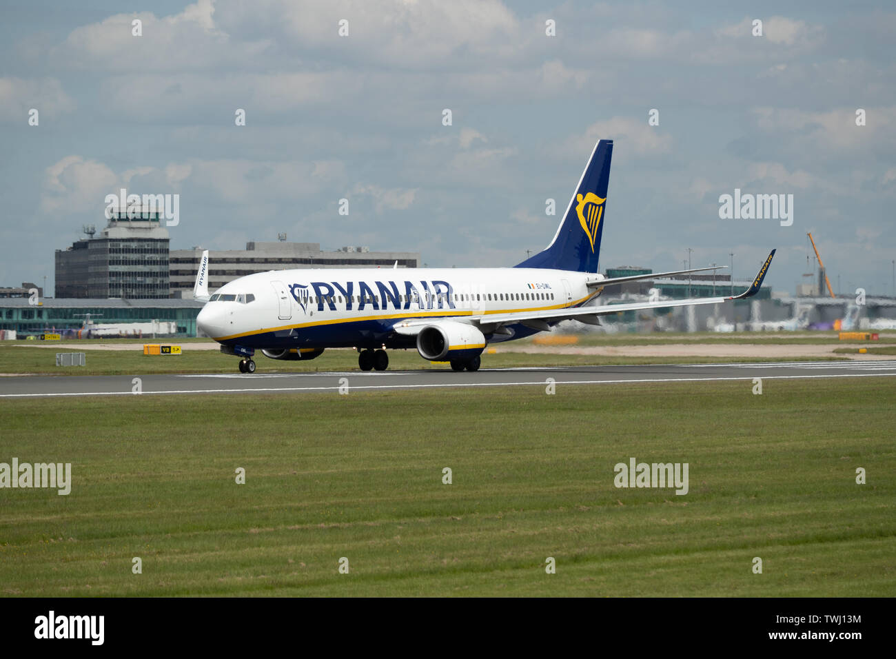 A Ryanair Boeing 737 travels down Runway Two at Manchester International Airport in Wilmslow, United Kingdom on Wednesday June 19 2019. Stock Photo
