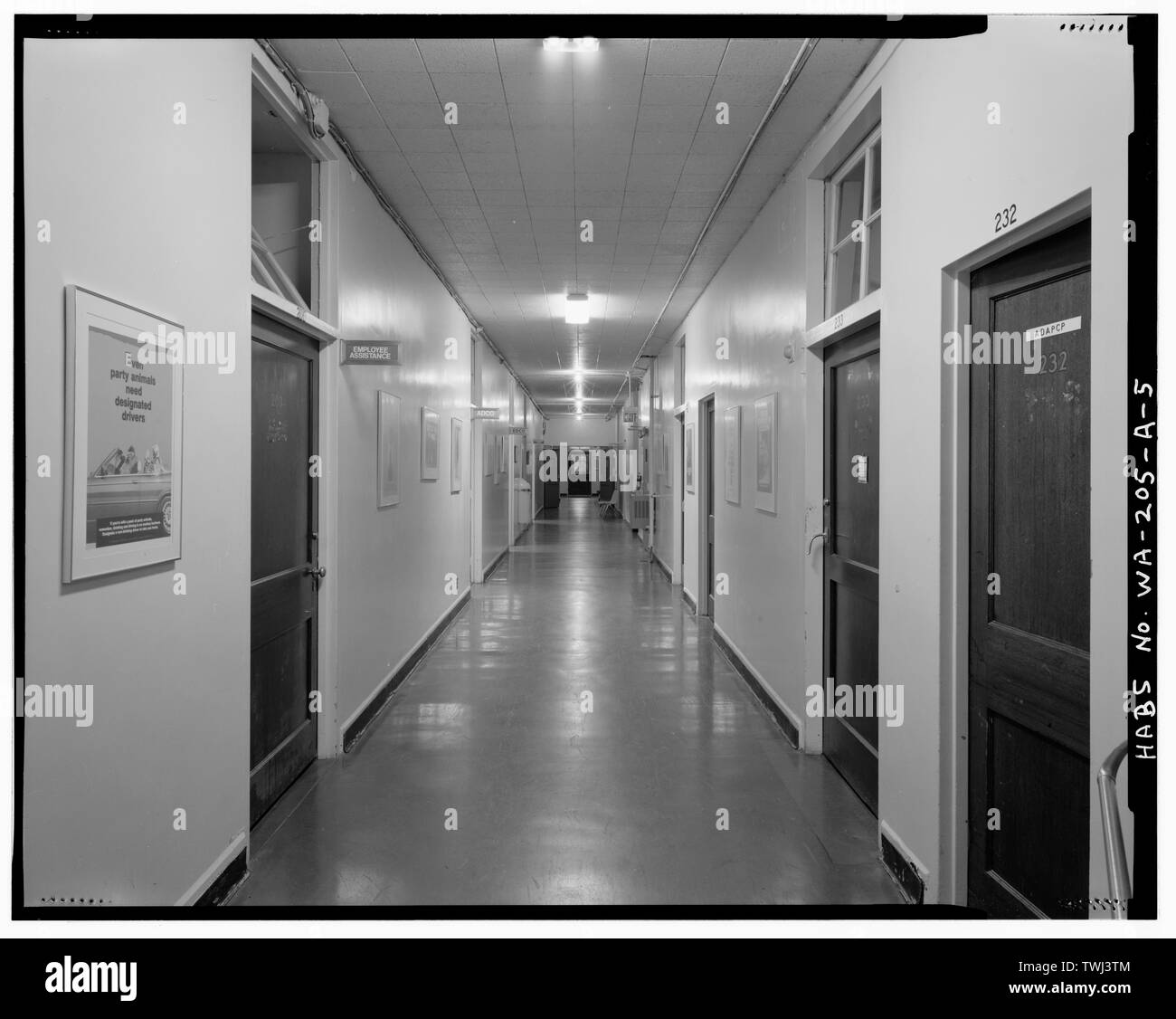 Second floor hallway running SW-NE. Nearest doors with transoms are Room 203 on left and Room 233 on right. - Fort Lewis, Post Hospital, Near Ninth Division Drive and Idaho Avenue, DuPont, Pierce County, WA; Maul, David, transmitter - Stock Image