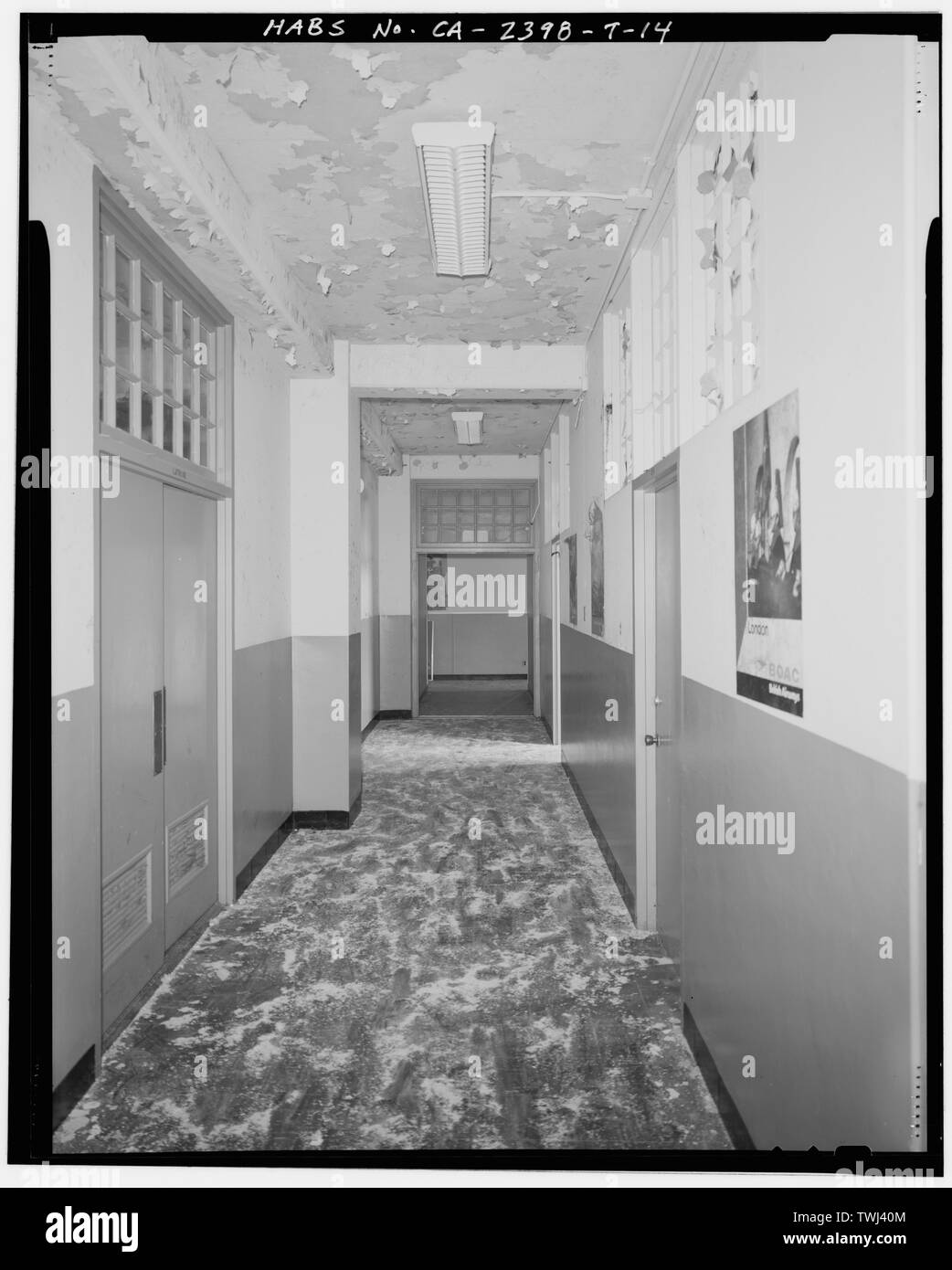 Second floor long axis hallway, showing transoms. Latrine at left. - Hamilton Field, Air Corps Dormitories, Fifth and Sixth Streets between Escolta and Hangar Avenues, Novato, Marin County, CA - Stock Image