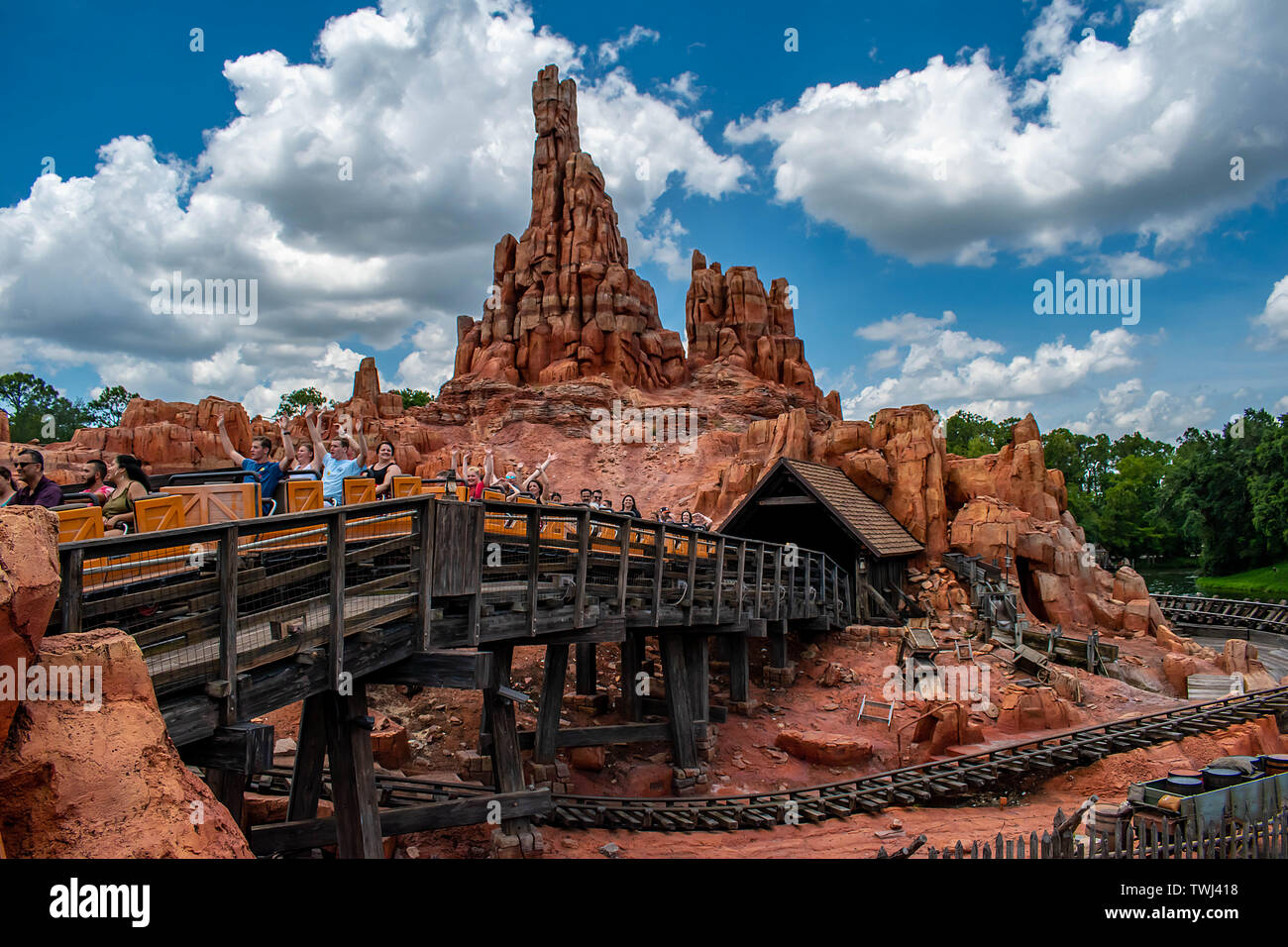 Orlando, Florida. May 10, 2019. People having fun Big Thunder Mountain railroad on cloudy sky background in Magic Kingdom at Walt Disney World - Stock Image