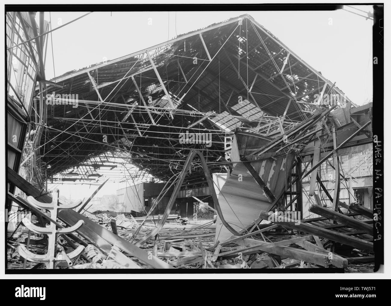 Senseless demolition in progress, showing destruction of perfectly decent and recyclable mill building. Problem exacerbated by high value of scrap iron. - Phoenix Iron Company, Rolling Mill, North of French Creek, west of Fairview Avenue, Phoenixville, Chester County, PA; DeLony, Eric N, project manager; Pennsylvania Department of Transportation, sponsor; Pennsylvania Historical and Museum Commission, sponsor; Lowe, Jet, photographer - Stock Image