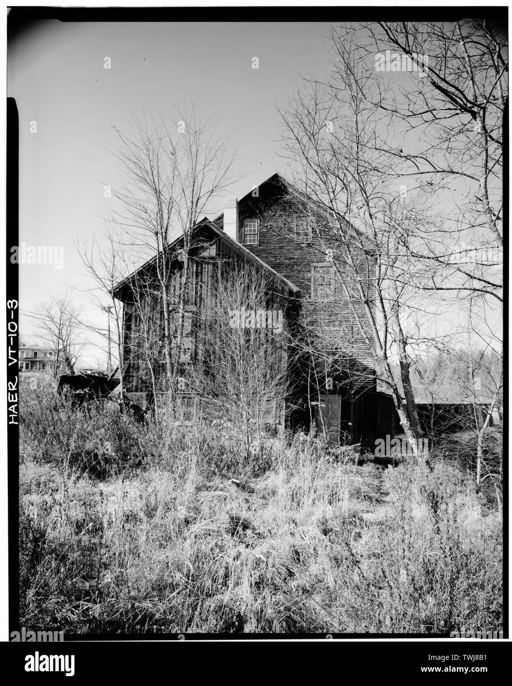 Side (southeast) elevation of Blacksmith Shop and Woodworking Mill. Timber frame and plank dam in right background; Ben Thresher's house in left background. - Ben Thresher's Mill, State Aid No. 1, Barnet, Caledonia County, VT; Rockefeller, Laurance S; Jack, Alexander; Judkins, James Loren; Stevens, Willard; Stevens, Henry; Gleason, Samuel; Barnet Cotton and Woolen Manufacturing Company; Herrin, John; Greenbank, Thomas; Greenbank, George; Taylor, James; Goodwillie, James; Shaw, William; McLaren, James; Somers, James S; Alexander Jack's Dye and Print Works; Smith, Isaac M; Bishop, Ora; Ford, Elm - Stock Image