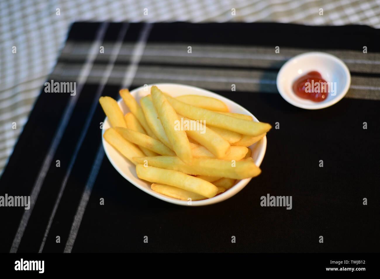 Crispy potato chips, setup nicely on table ready to serve - Stock Image