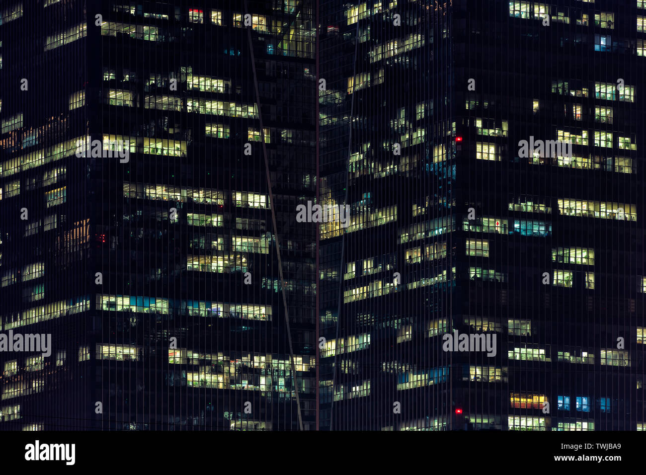 Night view of a modern glass skyscraper during overtime Stock Photo