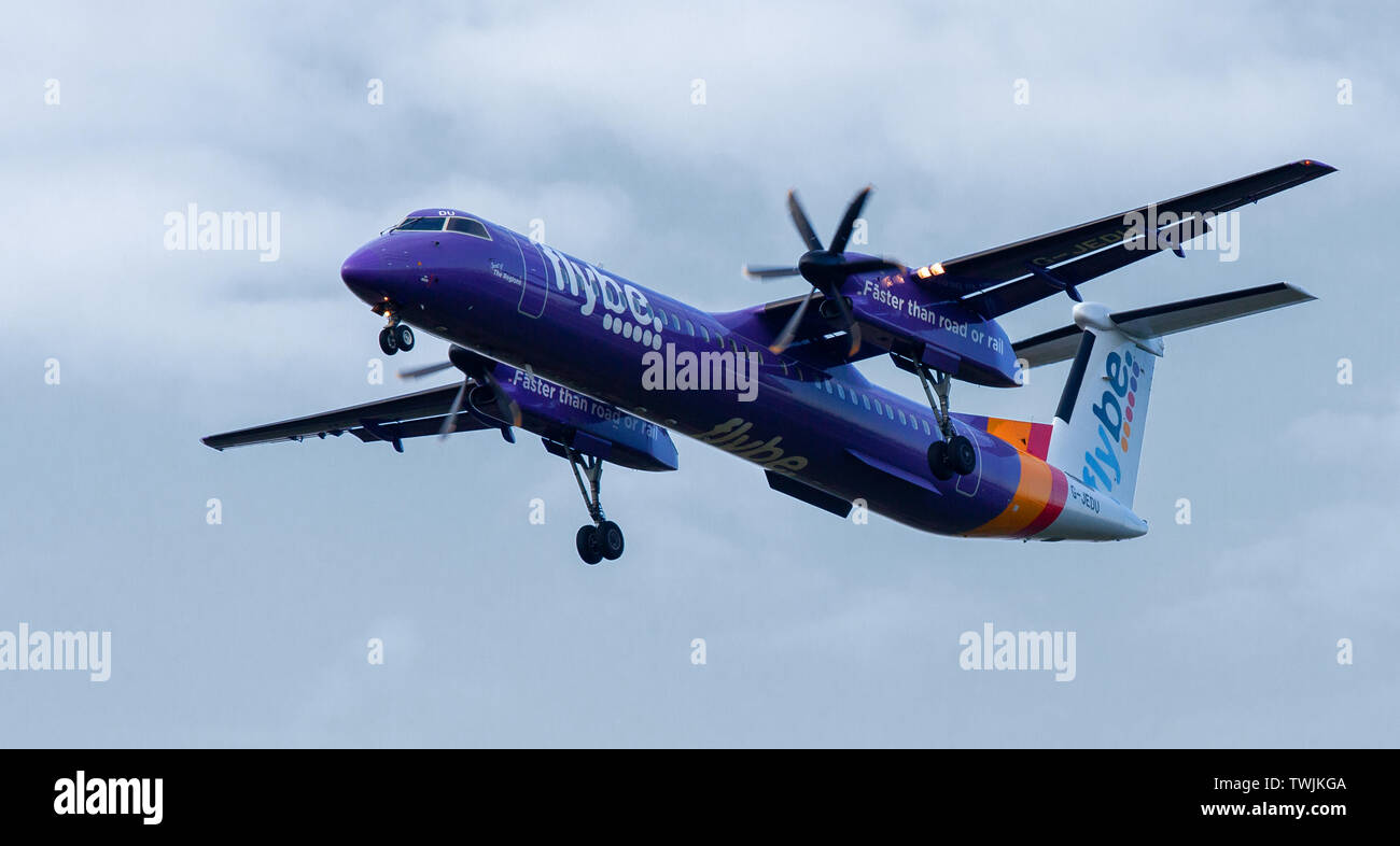 Flybe de-Haviland Canada DHC 8 Dash 8 G-JEDU coming into land at London Heathrow Airport LHR - Stock Image