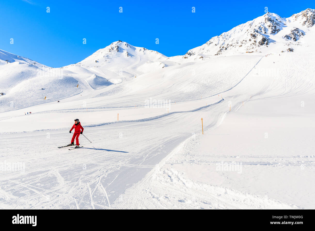 SERFAUS FISS LADIS SKI AREA, AUSTRIA - FEB 14, 2019: Woman skier on slope in amazing Austrian Alps in beautiful winter season, Serfaus Fiss Ladis, Tir Stock Photo