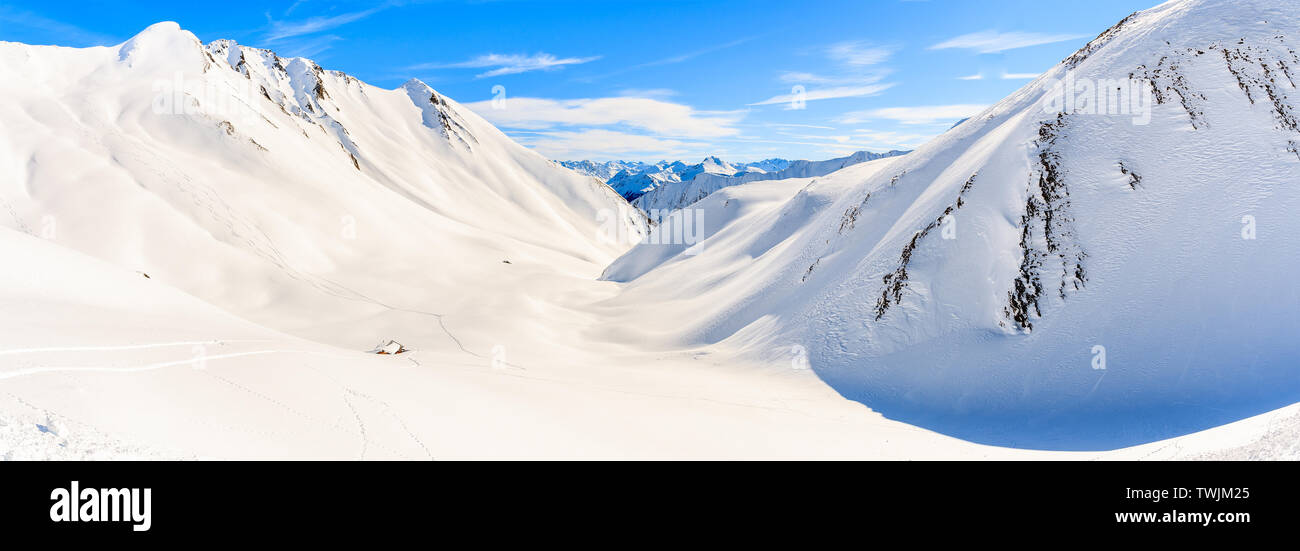 Small hut in valley and panoramic view of beautiful Austrian Alps mountains in winter snow, Serfaus Fiss Ladis, Tirol, Austria Stock Photo