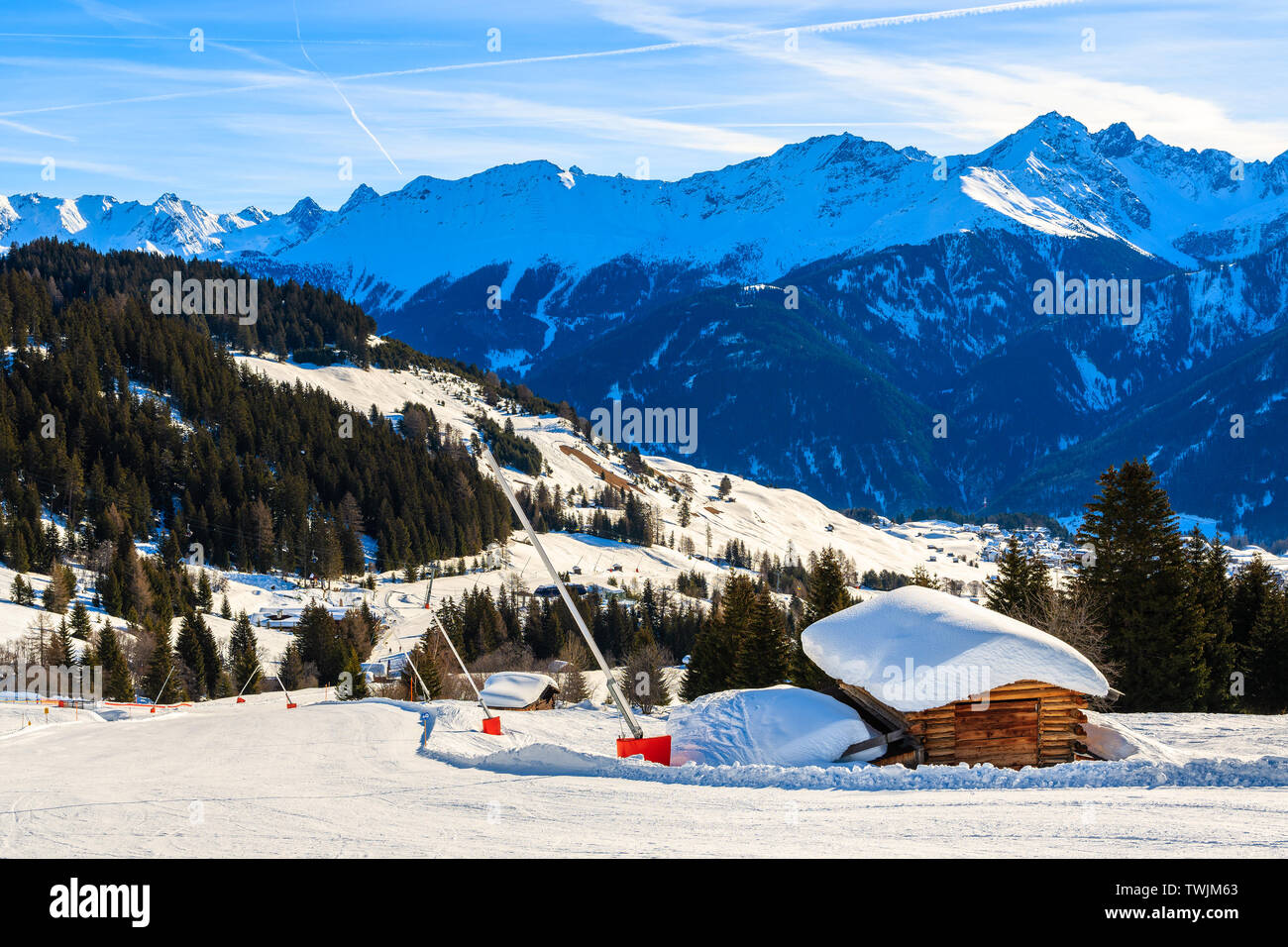 Wooden mountain hut with roof covered in snow on ski slope in Austrian Alps in beautiful winter season, Serfaus Fiss Ladis, Tirol, Austria. Stock Photo