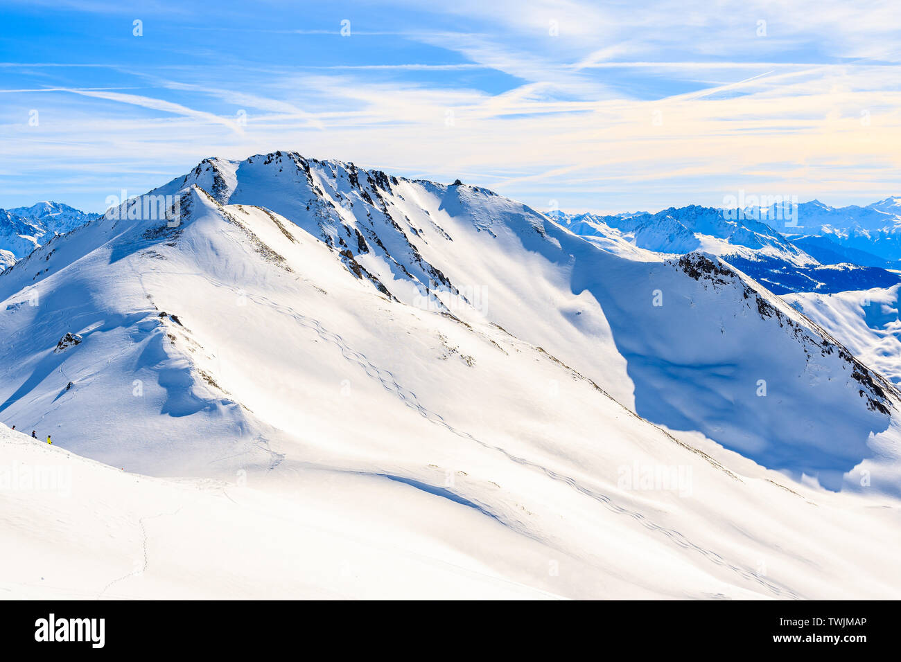View of ski slope and amazing Austrian Alps mountains in ...
