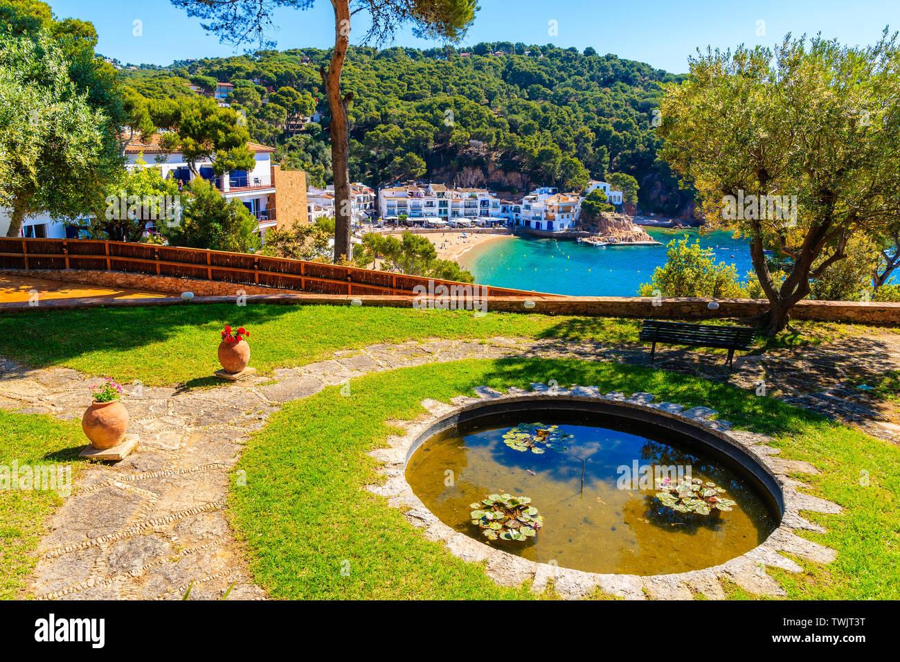 Water pond in garden and view of sea bay in Tamariu fishing village, Costa Brava, Spain Stock Photo