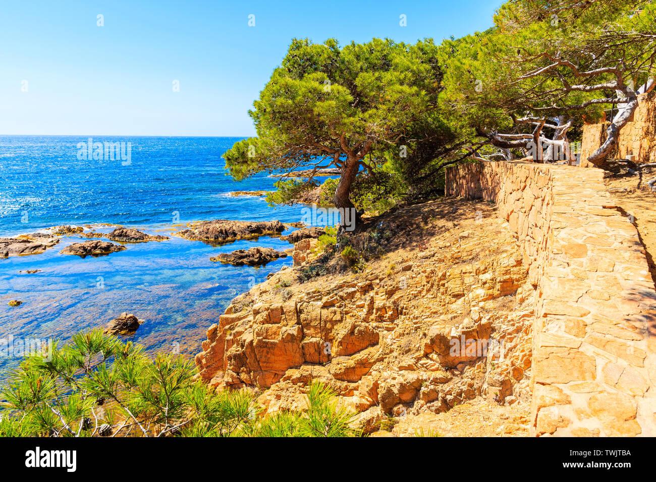 Trekking path along seacoast from Cala Aigua to Cala Marquesa, Costa Brava, Spain Stock Photo