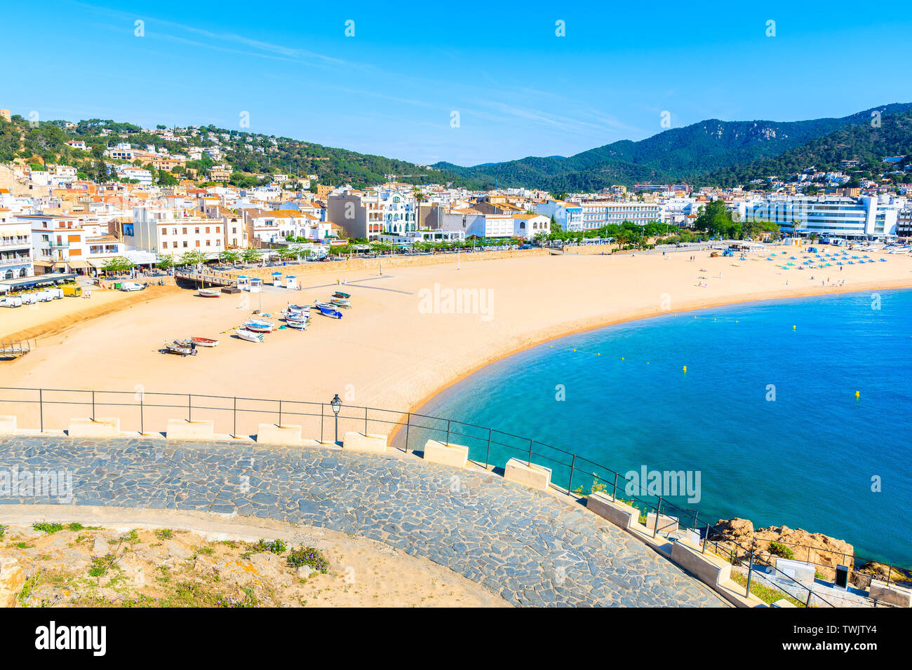 View of sandy beach and bay in Tossa de Mar town from castle, Costa Brava, Spain Stock Photo