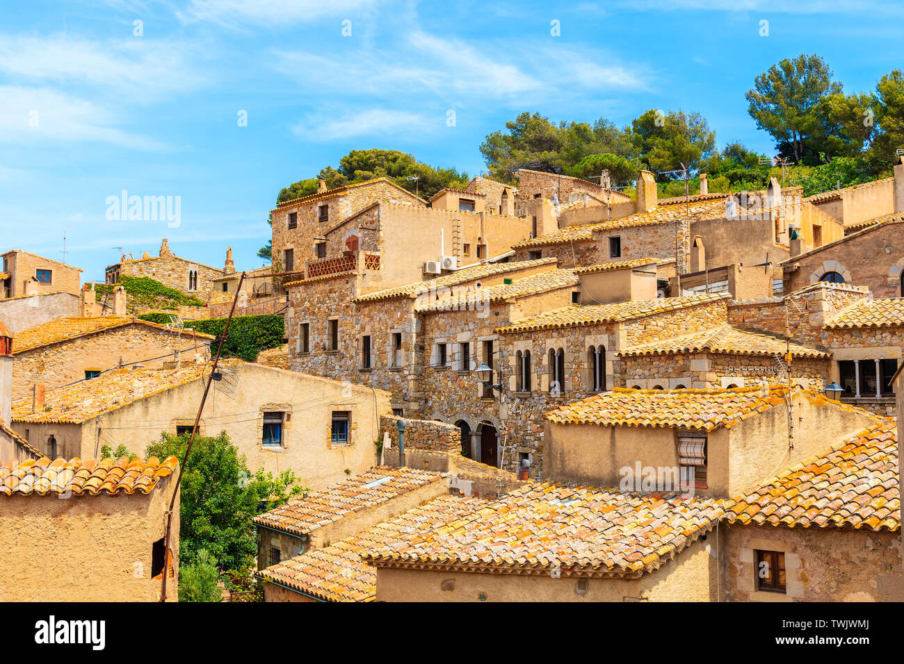 Stone houses with orange tile roofs in old town of Tossa de Mar, Costa Brava, Spain Stock Photo