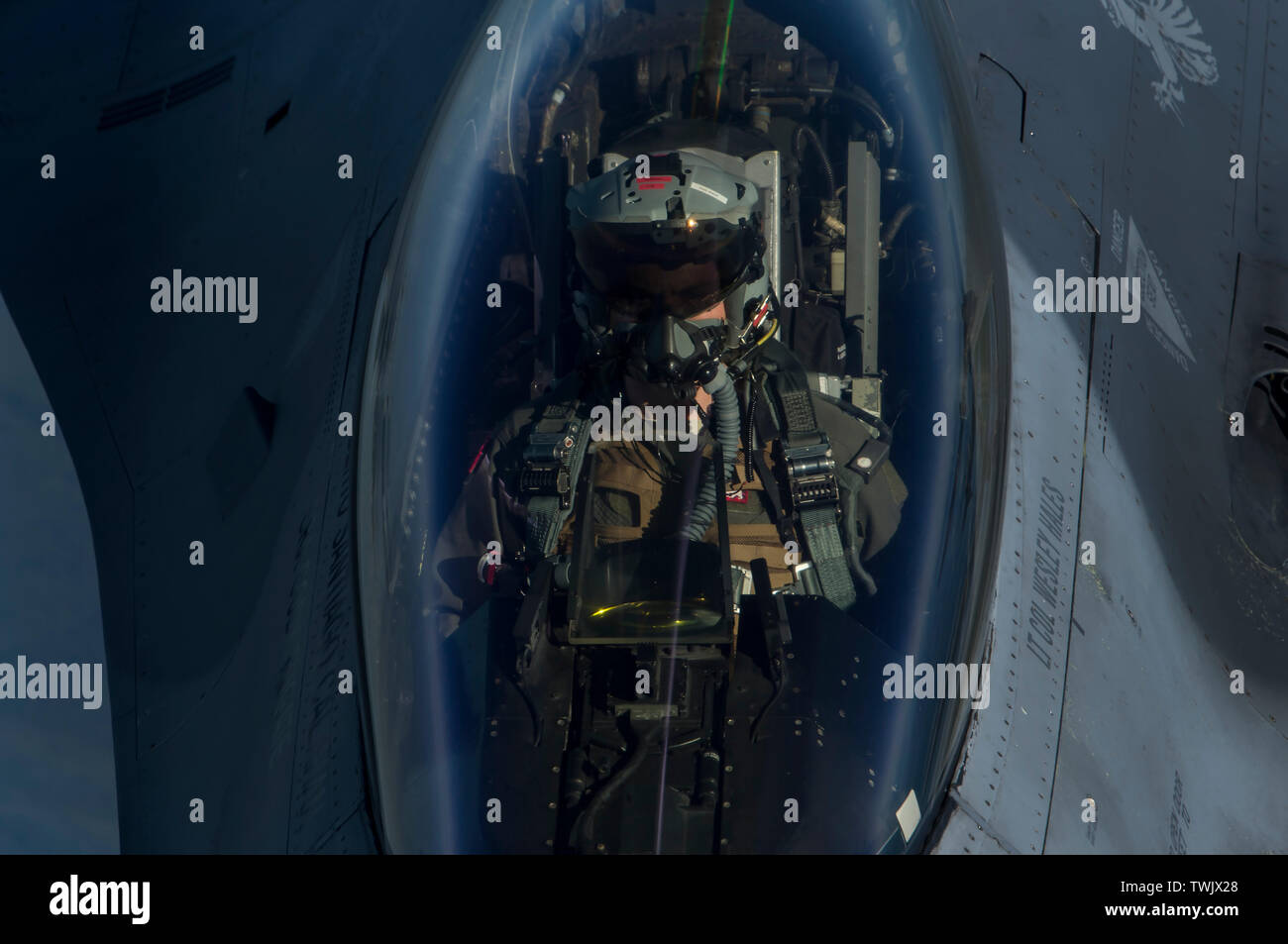 A U.S. Air Force F-16 Fighting Falcon pilot from the 13th Fighter Squadron, Misawa Air Base, Japan, receives fuel from a KC-135 Stratotanker during RED FLAG-Alaska 19-2 near Eielson Air Force Base, Alaska, June 18, 2019. RF-A is an annual U.S. Pacific Air Forces field training exercise for U.S. and international partners to enhance combat readiness of participating forces. The KC-135 is assigned to the 909th Air Refueling Squadron, Kadena Air Base, Japan. RF-A is an annual U.S. Pacific Air Forces field training exercise for U.S. and international partners to enhance combat readiness of partici - Stock Image